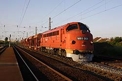 MAV Nosztalgia M61.006 provides the traction for a ballast train while it is overtaken by a southbound Rail Cargo Hungary freight train with MAV 630 012 at the helm at Emod on 20 May 2014.