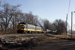 Keokuk Junction Railway 1752 + 1750 + PREX 2003 shunt freight cars in Mapleton, Illinois on 9 March 2015.