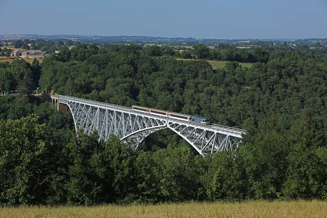 SNCF 567523 takes three empty sleeper coaches from Rodez to Albi Ville across the impressive Viaduc de Viaur (the first large steel bridge built in France completed in 1902) near Tanus on 18 June 2017.